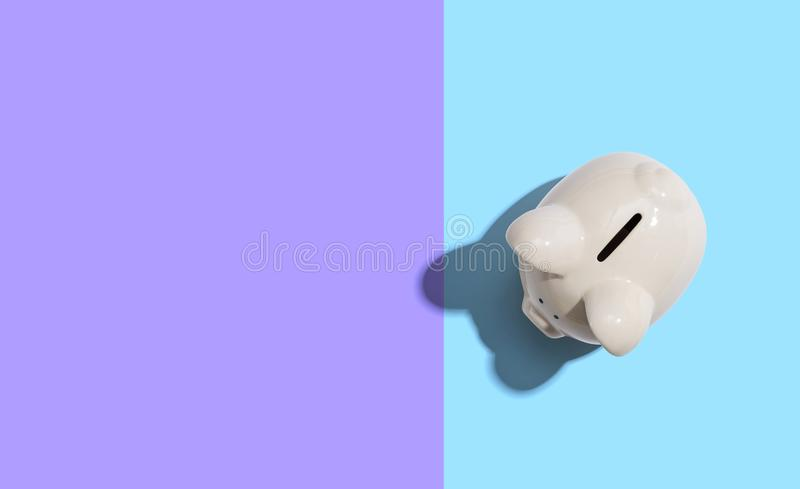 A white piggy bank overhead view. Flat lay royalty free stock photo