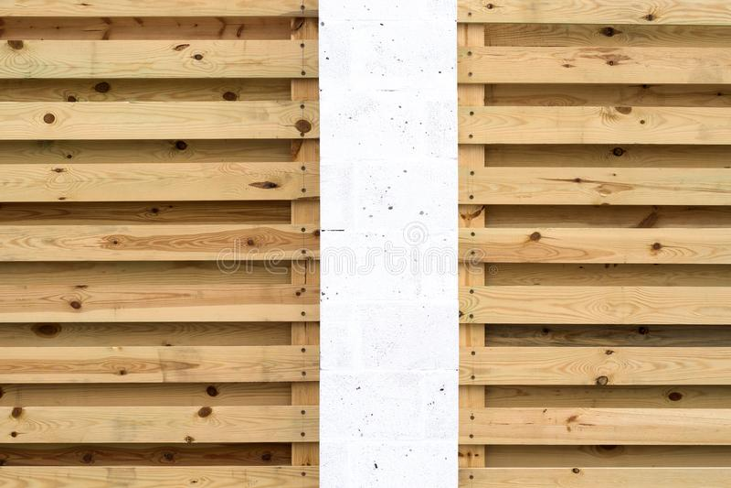 White pillar and background of wooden horizontal slats.  royalty free stock photo