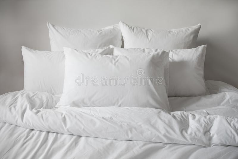 White pillows, duvet and duvetcase in a bed. Side view royalty free stock photography