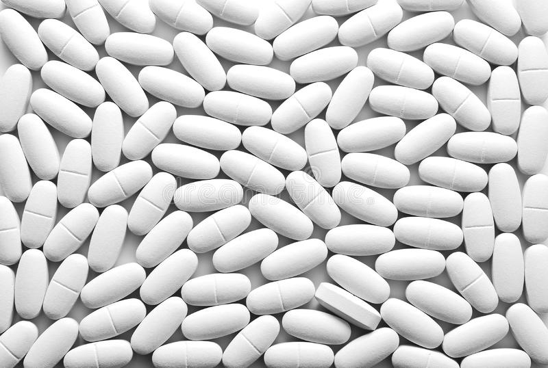 White pills background royalty free stock photography