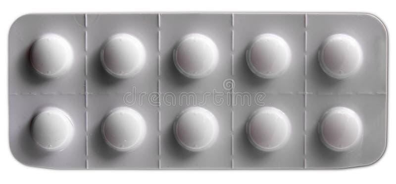 White pills blister pack. Full white blister pack of ten white pills isolated over white royalty free stock images