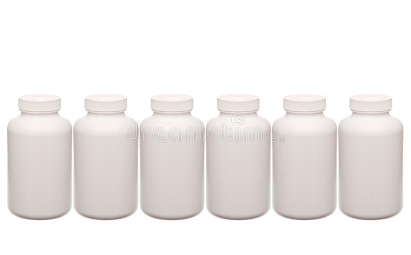 White pills containers in a row stock images