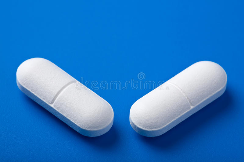 Download White pills over blue stock photo. Image of pharmaceutical - 14157102