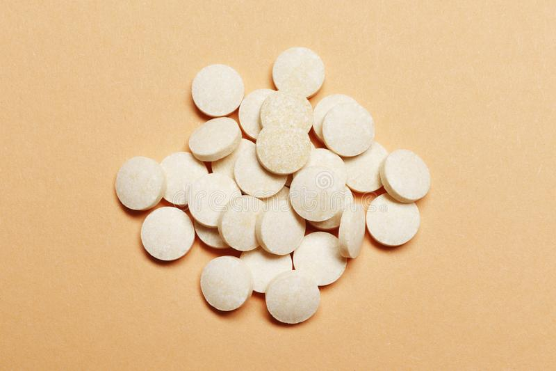 White pills on a pink background stock photography