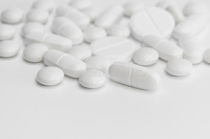 White pills / tablets /medicine - medical background. Pills / capsules /medicine / tablets close up royalty free stock photo