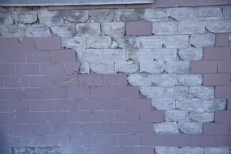 White pinck broken brick wall stock photography