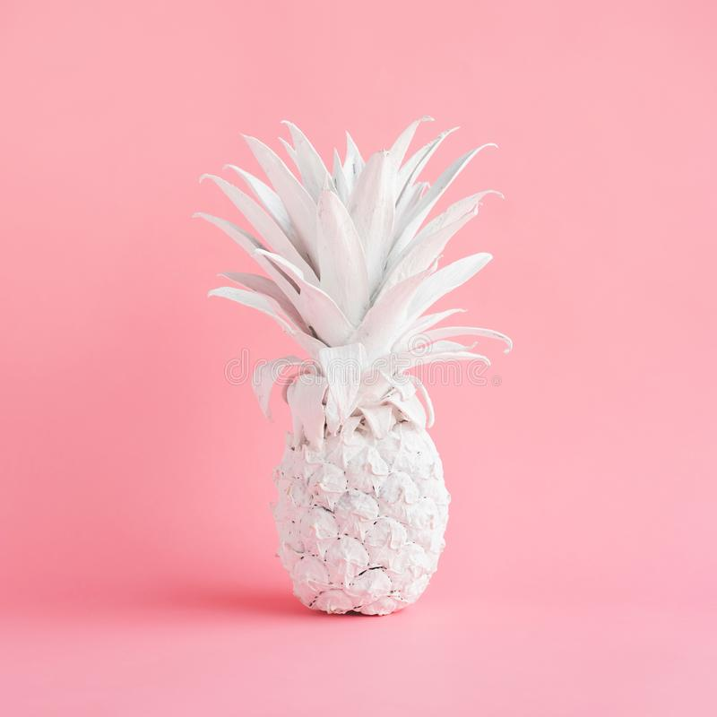 White pineapple on pink pastel color background. stock photo