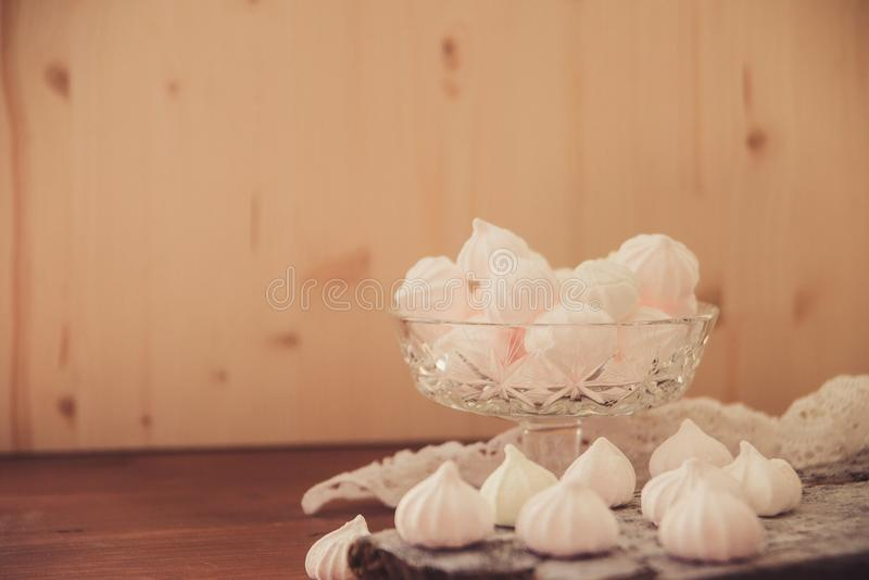 Pink meringue cookies. White and pink meringues in a vase royalty free stock photography