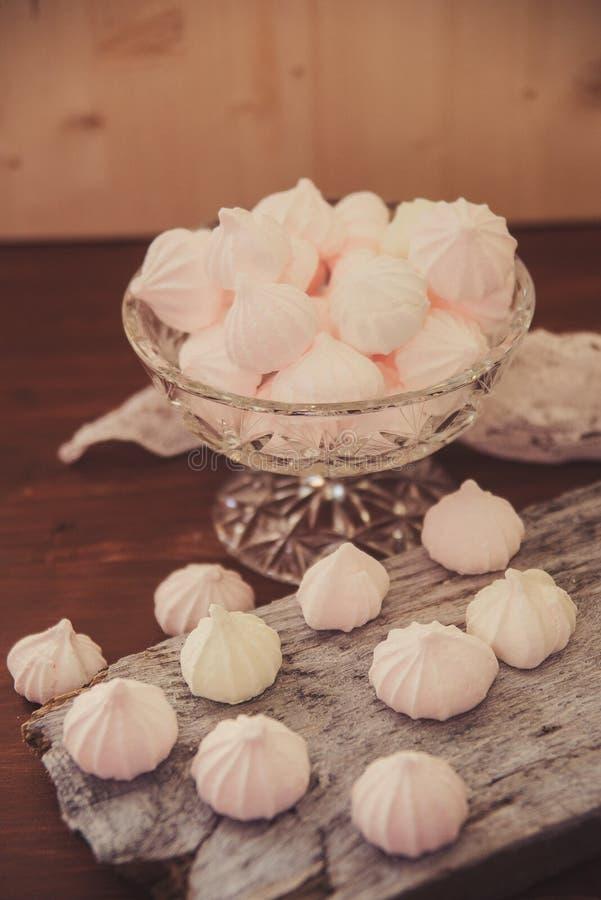 Pink meringue cookies. White and pink meringues in a vase stock photos