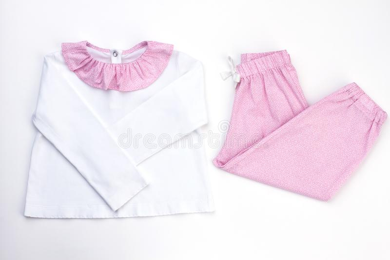 White and pink pajama set. Soft cotton jacket and loose-fitting pants with drawstring. Wear for good night`s rest royalty free stock image