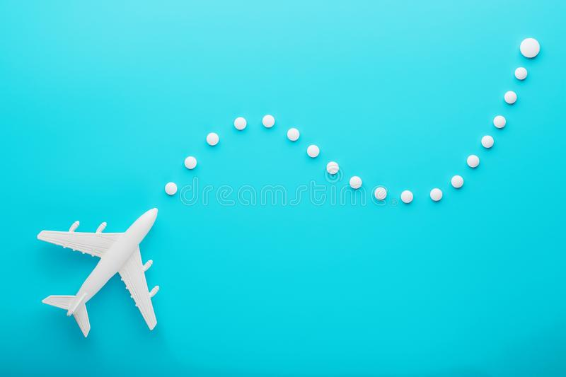 White plane on a blue background with a flexible and smooth trajectory of the route from white points royalty free stock photo