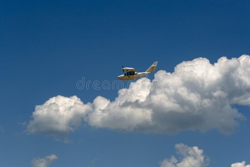A white plane flying in the blue sky. stock photos