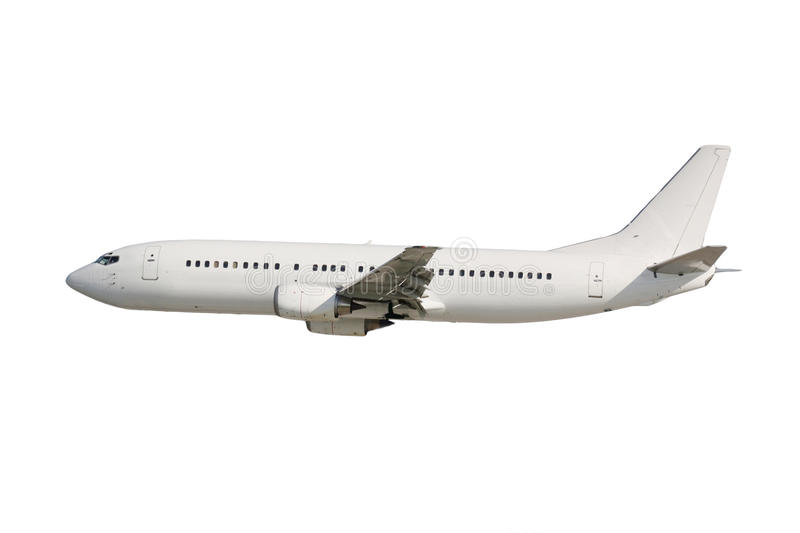 White plane. Isolated on white background in flight royalty free stock photography
