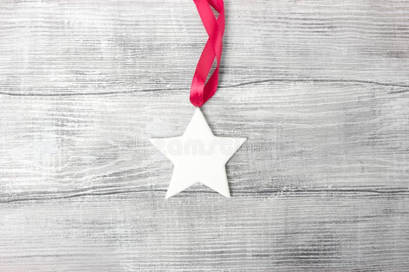 White plaster star on wooden background stock photography