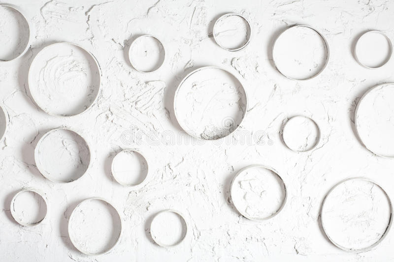 A white plastered wall with abstract circles royalty free stock photography
