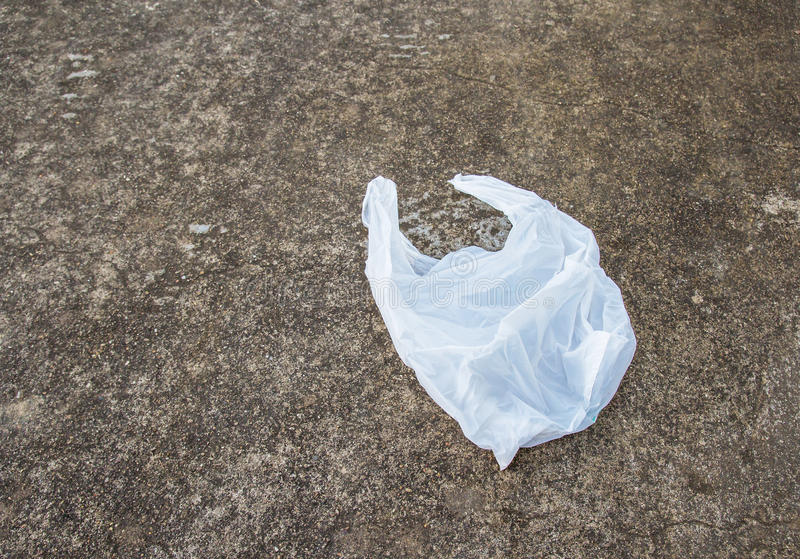 White plastic bags on the concrete floor. White plastic bags lay on the concrete floor stock photography