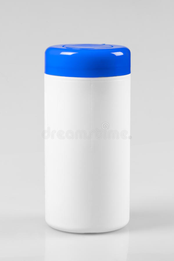 White plastic container with a blue lid royalty free stock images