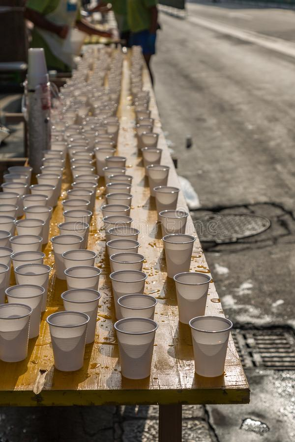 White Plastic Cups on Table during City Marathon Race Event.  royalty free stock image