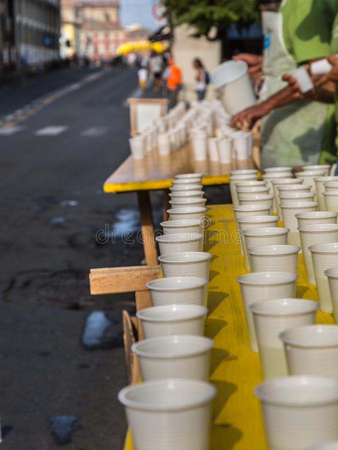 White Plastic Cups on Table during City Marathon Race Event.  royalty free stock images