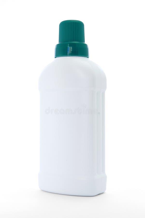 White plastic bottle with green cap hygiene container. White plastic detergent bottle green cap isolated no background studio lighting stock photography