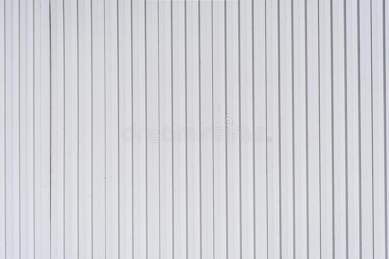 White plastic siding panels for texture background. White plastic siding panels for texture or background stock photo