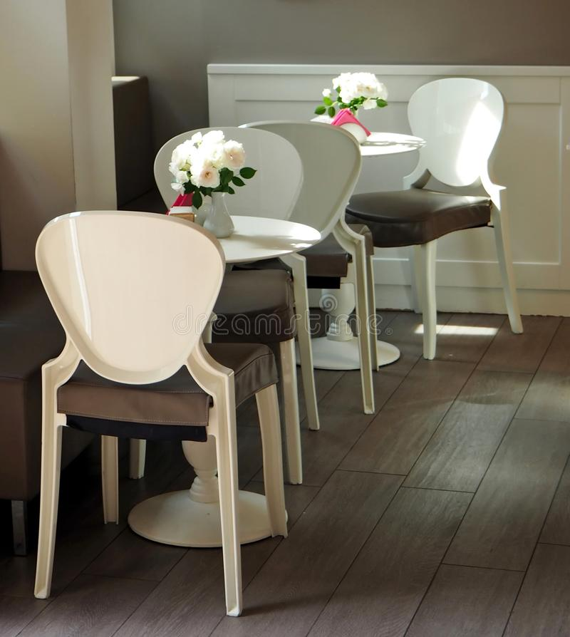 White plastic tables and chairs, cafe bar furniture. For interiors royalty free stock photo