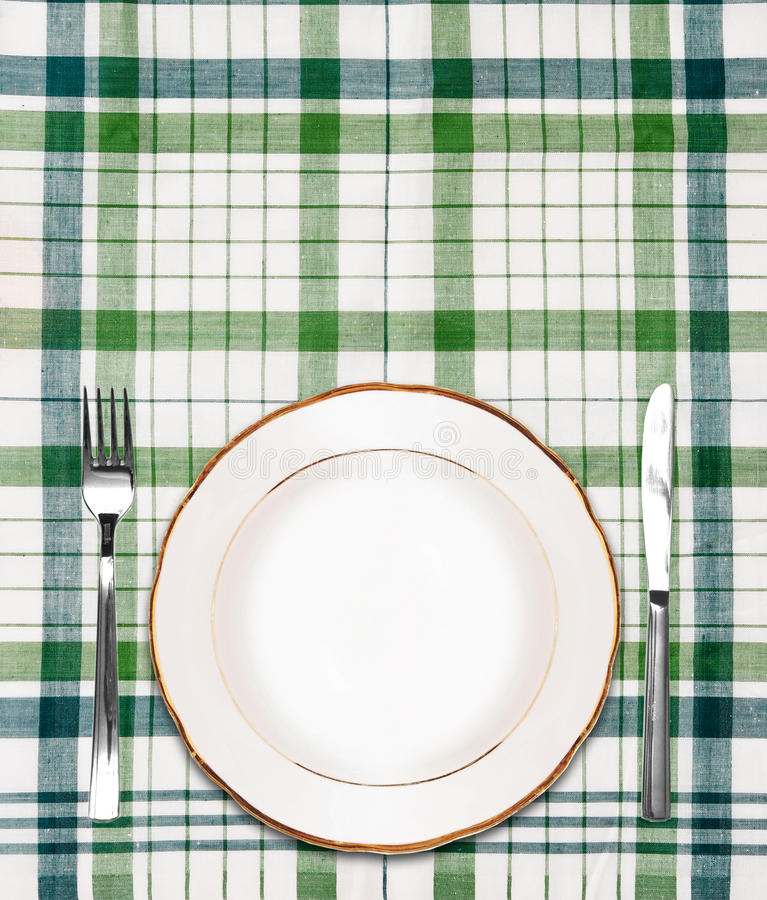 Download White Plate On Green Checkered Tablecloth Stock Photography - Image: 20744232