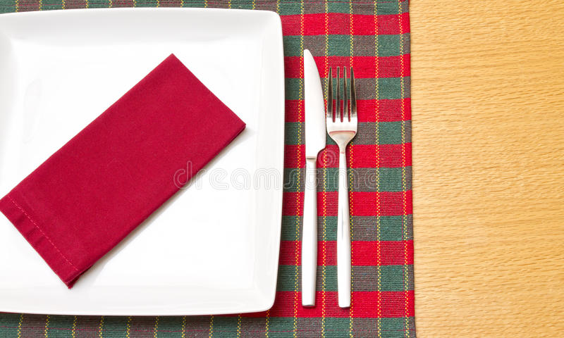 Download White Plate On Green And Red Tablecloth Stock Photo - Image: 22282512