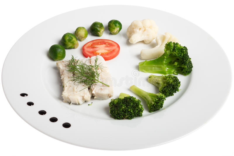 White plate with healthy food fish and vegetables royalty for Fish and broccoli diet