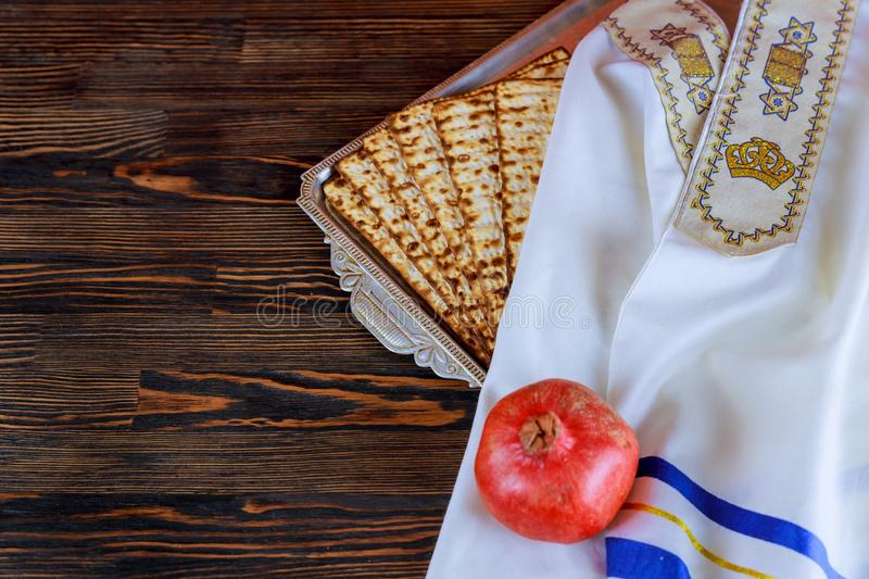 White plate with matzah or matza and Passover Haggadah on a vintage wood. Background presented as a Passover seder feast or meal with copy space. Perfect for royalty free stock images