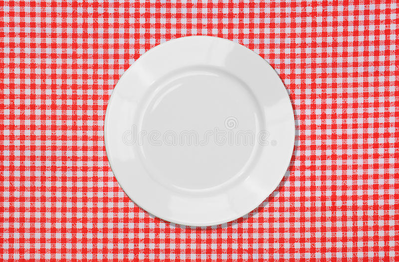 Download White Plate On Red And White Tablecloth Stock Image - Image: 24501927