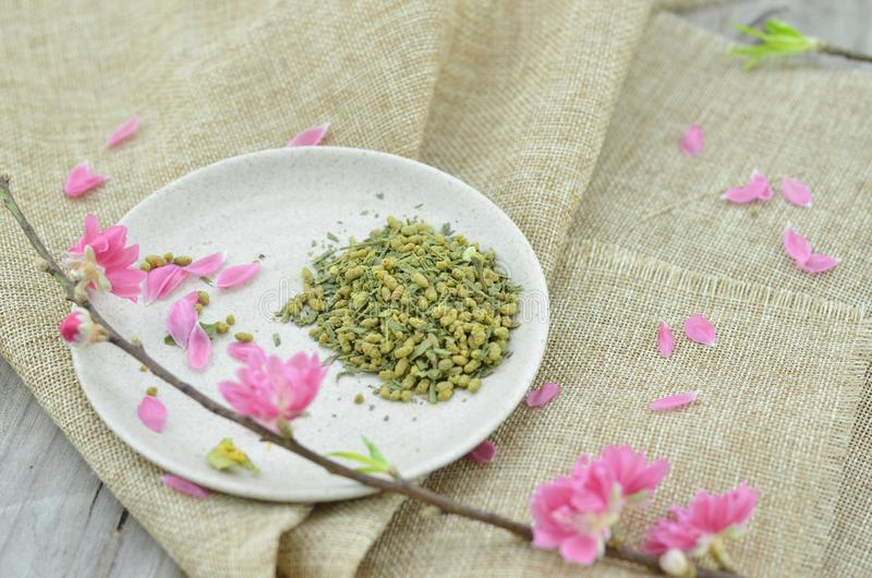 White plate with rice tea and peach flower blooming stock photo
