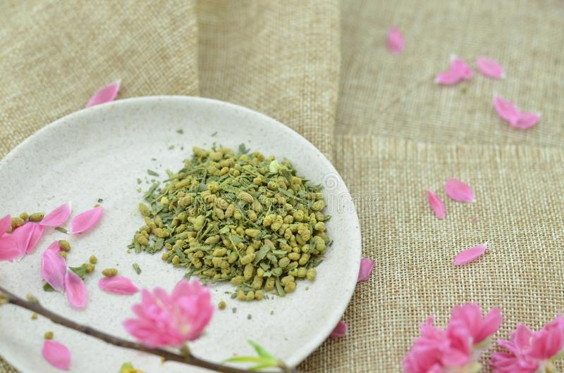 White plate with rice tea and peach flower royalty free stock photography