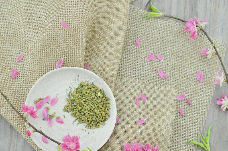White plate with rice tea and peach flower blossoming royalty free stock photos