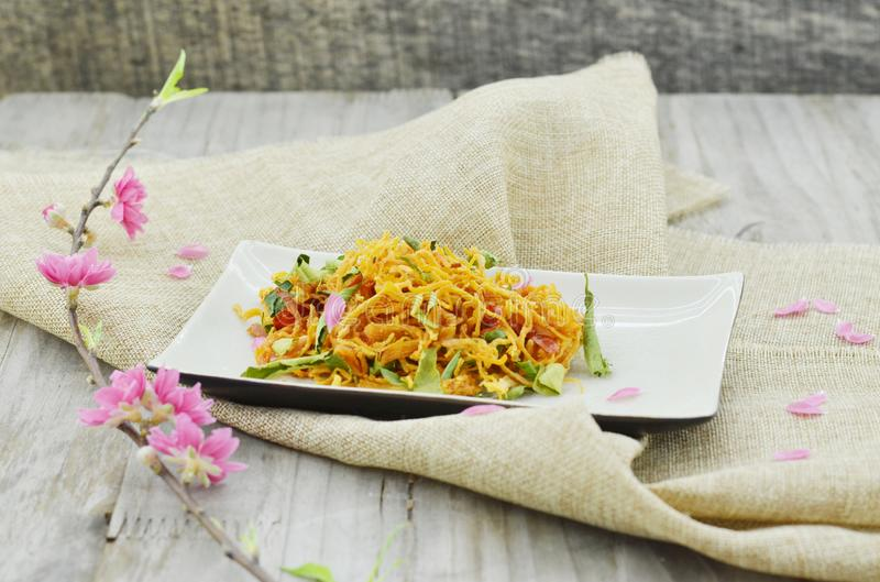 White plate with shredded dried chicken on wooden table royalty free stock images