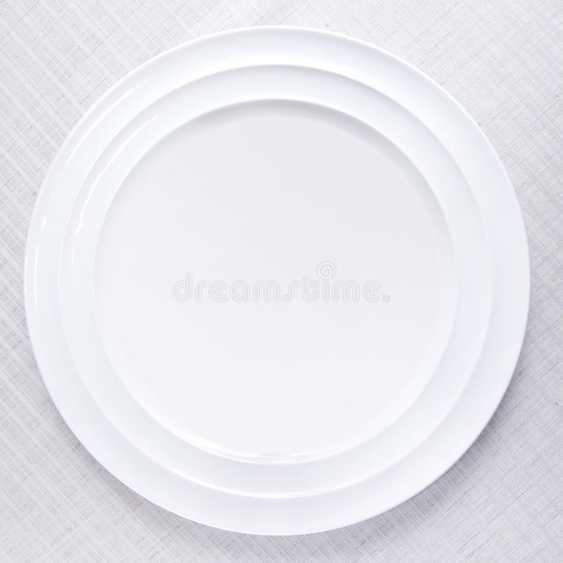 Download White plate on tablecloth stock image. Image of cloth - 13768715