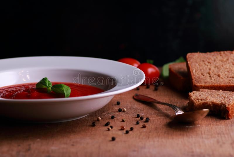 White plate with tomato soup stock photography