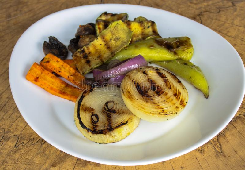 Roasted vegetables. Onions, carrots, peppers, zucchini and mushrooms. royalty free stock images