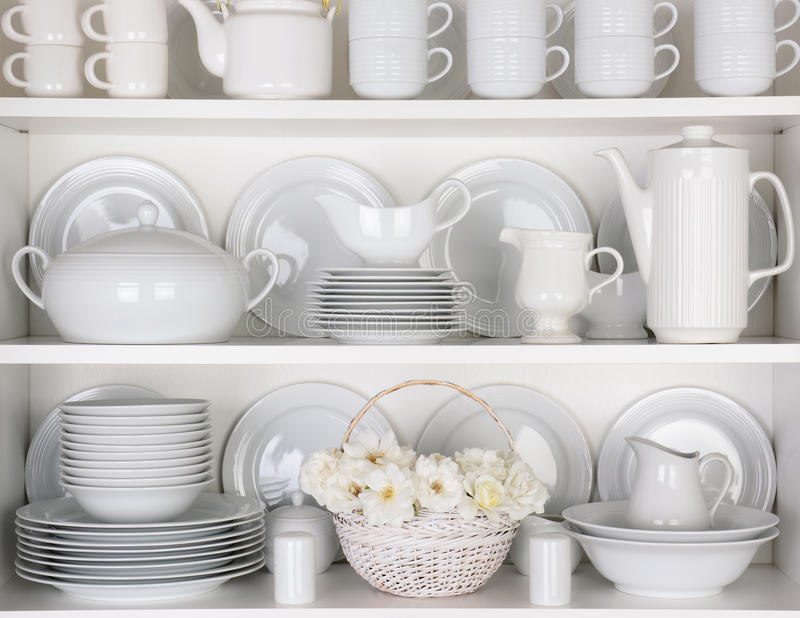 White Plates in Cupboard royalty free stock images