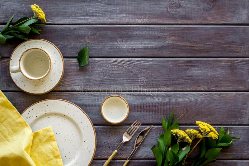 White plates and dandelion frame for table setting on wooden background top view mock-up royalty free stock photography
