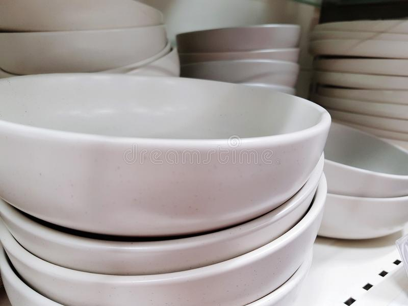 White plates for sale royalty free stock photo