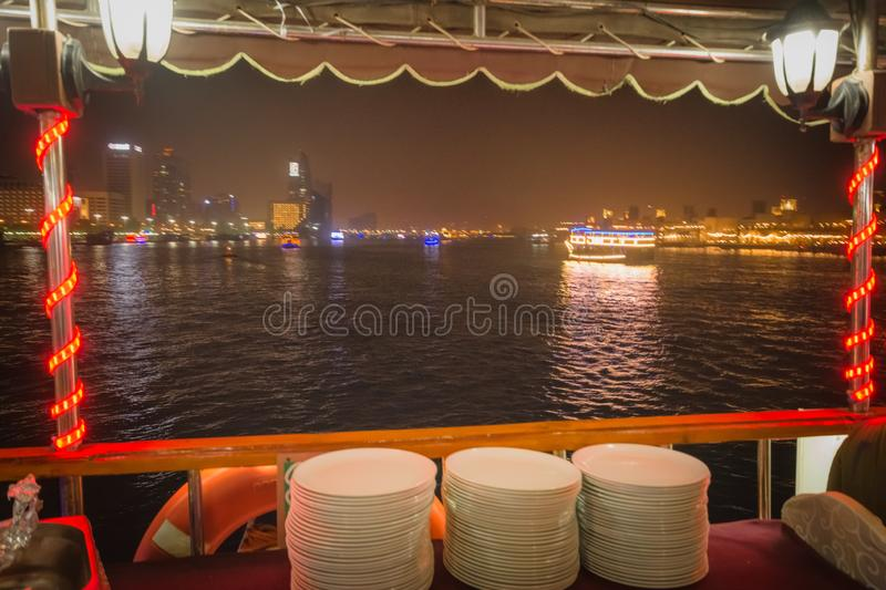 White plates stacked on a Floating Restaurant. Dubai, UAE- August 10, 2019: White plates stacked on a Floating Restaurant stock photos
