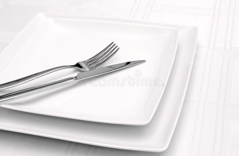 White Plates On White Tablecloth Stock Photos