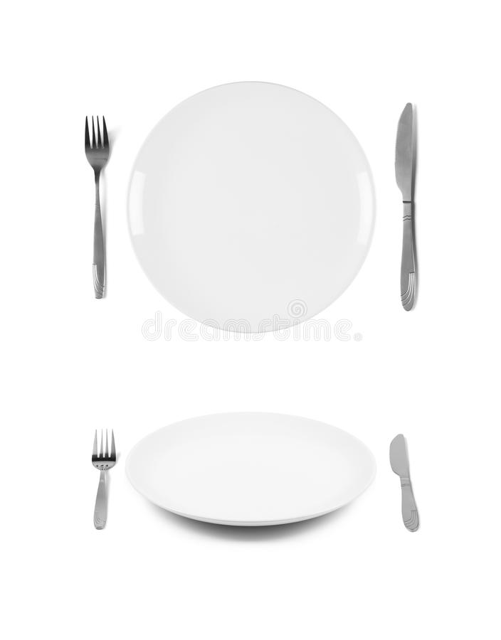 Free White Plates With Fork And Knife Royalty Free Stock Photography - 103867037