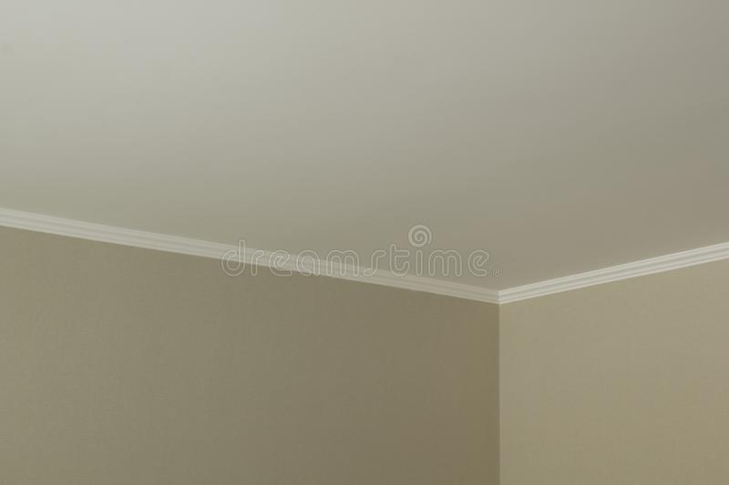 White plinth on the ceiling of drywall. Ceiling repair modern royalty free stock photo
