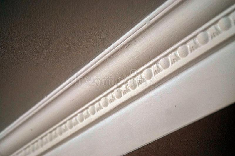 White plinth on the ceiling of drywall closeup. White plinth on the ceiling of drywall stock photos