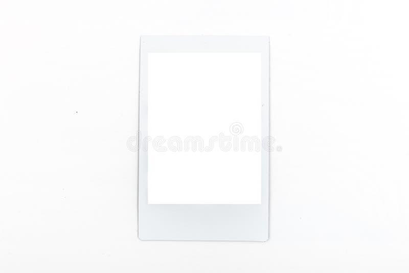 White polaroid mockup frame on white background. White polaroid mockup frame of portrait formate on white background royalty free stock photography