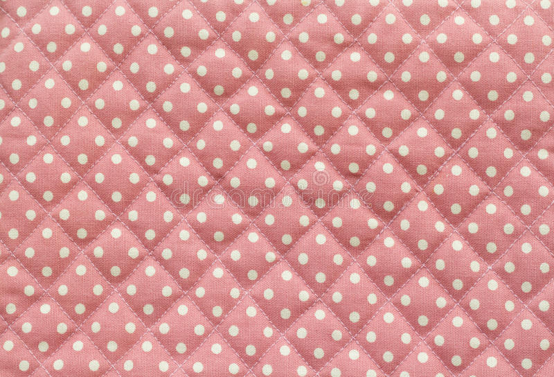 White Polka dot over pink fabric table texture background royalty free stock images