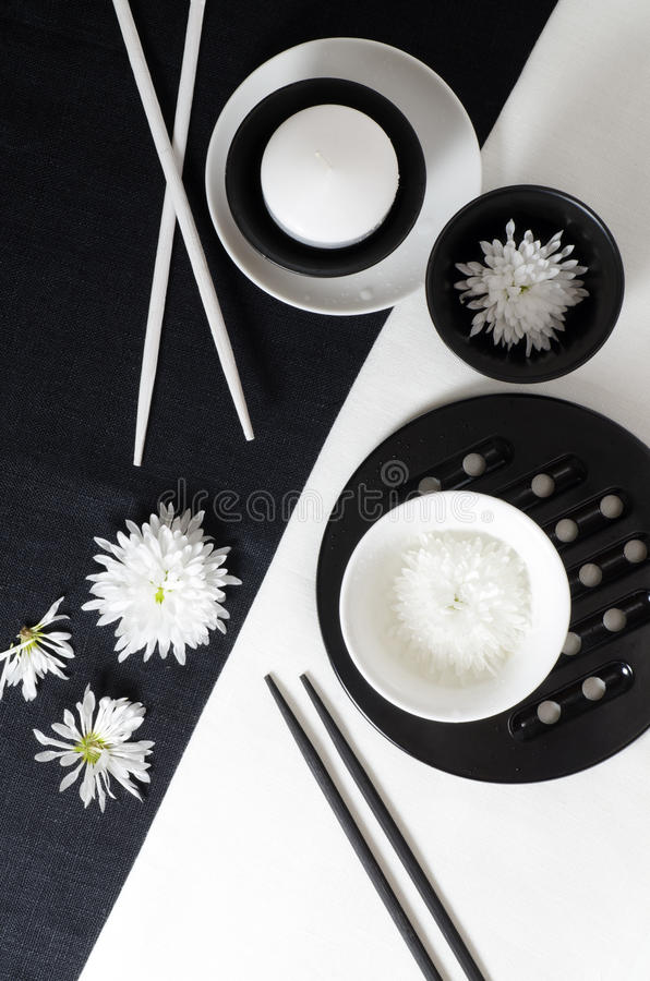 White porcelain on black and white linen tablecloths. royalty free stock image