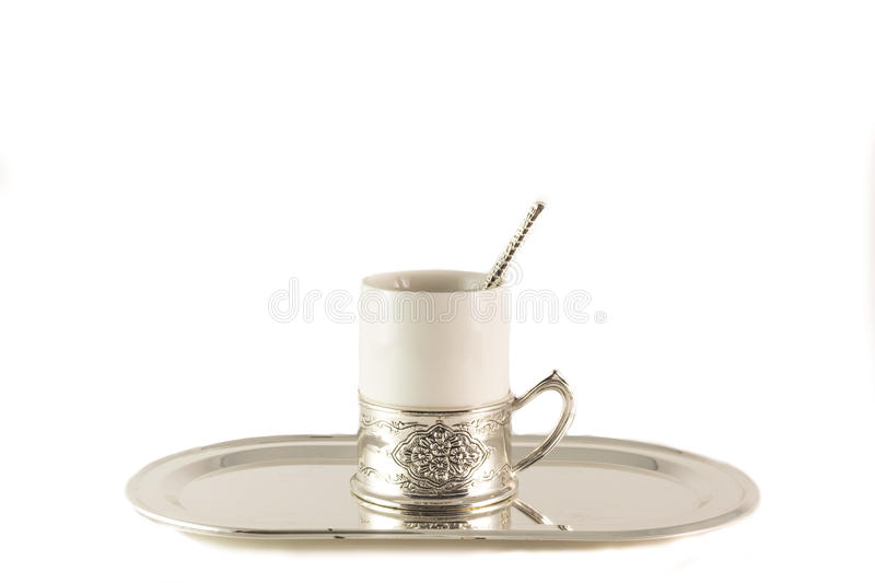 White porcelain coffee Cup with silver spoon on tray stock images
